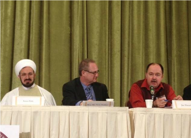 Panel at a conference supporting marriage held Monday at the Islamic House of Wisdom in Dearborn Heights. (Left to right) Imam Mohammad Ali Elahi, head of the mosque, Rev. Nick Phillips, marriage pastor at NorthRidge church in Plymouth, Jim Thienel, chairman of Oakland County Republican Party. / Niraj Warikoo/DFP